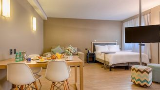 Executive Suite with a double bed and sofa bed for up to 4 people