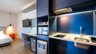 Apartment with double bed and kitchen adapted for people with disabilities
